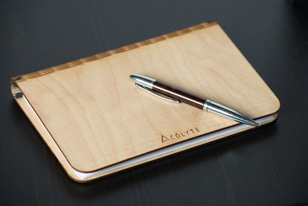 Press kit | 884-04 - Press release | HEC Project 2014 Edition - Faculté d'aménagement de l'Université de Montréal - Industrial Design - Acolyte<br><br>The  acolyte is a sketchbook made out of Russian birch plywood which was  laser cut and within which one can easily switch-out the sheets (8 ½ x  11) due to the elastic holding them in place. It is the perfect  accomplice to your creativity.<br><br>Tara Harb<br>Maxim Lamirande<br>Gaëtan Nkamegue - Photo credit: Olivier Ouimet 2014 - www.olivierouimet.com