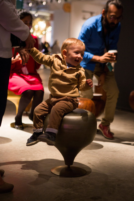 Press kit | 1604-06 - Press release | Design Days Dubai Completes It Fifth And Most Successful Edition To-Date - Design Days Dubai - Event + Exhibition -  Child enjoying the spinning 'Lattoo' stool by Coelesce (Pakistan),  Design Days Dubai 2016  - Photo credit: Design Days Dubai (2016)