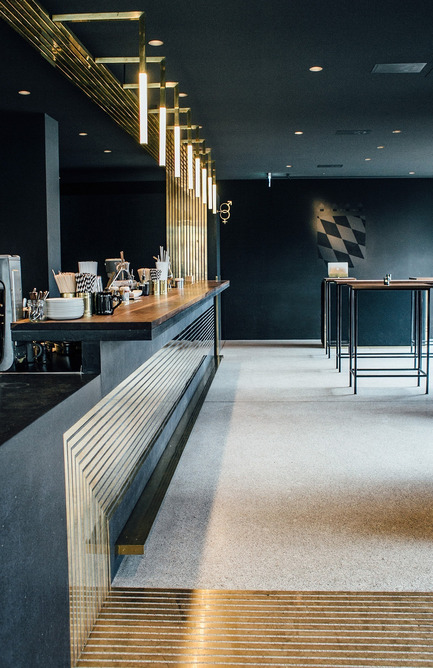 Press kit | 1124-09 - Press release | WIN Awards - Hospitality Shortlist Announced - World Interiors News - Commercial Interior Design - WIN Awards 2016 - Restaurants Category: Herzog by Build Inc. Architects (Germany)<br><br>One of the most prominent challenges was working with a revered heritage listed building and the challenges we faced wanting to respect and highlight it on one side, and on the other side trying to meet the high standard and quality of gastronomy spaces in our contemporary world today. <br><br>Materials such as Brass and textured concrete reinterpret the terrazzo floors and further strengthen the material imprint of the public buildings of that time. <br><br>'The restaurant has beautiful detailing and a pleasing pairing of materials. We loved the thread that goes through the restaurant with the copper line. The furniture is beautiful Bauhaus inspired, but 'blinged-up' with some amazingly expensive materials, the colour palette is very pared back creating a calming and inspirational environment.' FT<br> - Photo credit: Build Inc. Architects