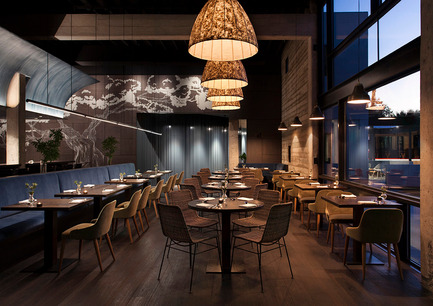 Press kit | 1124-09 - Press release | WIN Awards - Hospitality Shortlist Announced - World Interiors News - Commercial Interior Design - WIN Awards 2016 - Restaurants Category: Juniper by Cravotta Interiors (USA)<br><br>Executive Chef Nicholas Yanes wanted a space that would showcase the refined flavors of Northern Italy and expose Texans to a more European way of dining; to slow down and stay awhile. <br><br>Collaborating with Sanders Architecture, CI delivered a layered exploration of space and materiality, producing something that is exquisite as it is friendly. Blending lush velvets, concrete, wire-brushed Belgian oak, walnut paneling and handcrafted fixtures, the space is at once sexy, warm and industrial; a beautiful back drop to the meticulous menu and concierge service.<br><br>'We like the understated composition of this. However, when you take a closer look, you notice the raw concrete and stained oak. There are some nice graphic details interwoven into this project – overall a very calm and interesting space that isn't boring at all.' JD<br> - Photo credit: Cravotta Interiors