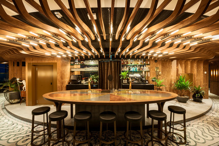 Press kit | 1124-09 - Press release | WIN Awards - Hospitality Shortlist Announced - World Interiors News - Commercial Interior Design - WIN Awards 2016 - Bars Category: A'DAM&Co by TANK (Netherlands) <br><br>ADAM&Co aspires to become THE members club for creative or open-minded people. The brief was to create a concept that is built around all members being part of a whole. Create a place where one can discover, create, make mistakes, be inspired, and make friends... Or simply grow. It should feel really unique, prestigious and special. <br><br>TANK has created a grand gesture that embraces all members as a whole; all their ideas, inspiration, creatures, thoughts, initiatives & moods. There's a place for every member on every moment of the day Shaped like an overwhelming, abstracted Tree of Life that gives you shelter and refers to intimacy, grounding and play.<br><br>'The ceiling is very intelligent in terms of unifying all of the circular space and we enjoyed the sophisticated mix of textures and materials.' MA<br> - Photo credit: TANK