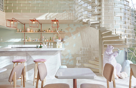 Press kit | 1124-09 - Press release | WIN Awards - Hospitality Shortlist Announced - World Interiors News - Commercial Interior Design - WIN Awards 2016 - Cafés Category: SHUGAA by party/space/design Co., Ltd (Thailand) <br><br>The interior concept for Shugaa is based on study of sugar in its basic molecular and crystal form. From the outside looking through the wall of glass, there is polygonal installation hanging around the front, inspired by sugar crystals. Wood material has also been used in the design together with a colour palette of mint green to make it feel warm and earthy. The designer team has added a dash of modern and luxury by using rose gold elements and a marble counter bar.<br><br>'From the design concept through to execution they have the designers have looked at all the aspects; the logo, the furniture the lighting, and you can see how they have carefully chosen the submitted compositions to really highlight all these details. A really lovely, bright, open, colourful space.' GS<br><br>'Very playful.' DA - Photo credit: party/space/design Co., Ltd