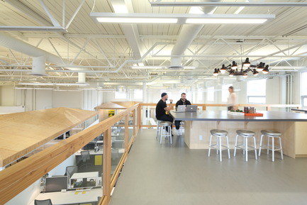 Press kit | 2073-03 - Press release | Innovative Interior Design Steps Up Tech Firm Startup - DIALOG - Commercial Interior Design - STAT Search Analytics' 2,000 sq. ft. second floor mezzanine and communal social space and eatery <br> - Photo credit: Ema Peter