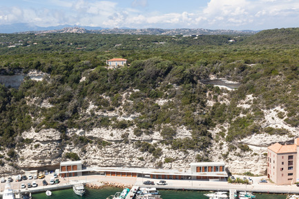 Press kit | 2380-01 - Press release | L'Ortu Duzzi Project - Buzzo Spinelli Architecture - Industrial Architecture - Ripped off the cliff, limestone pieces have chosen to dive into the port. - Photo credit: ©Serge Demailly
