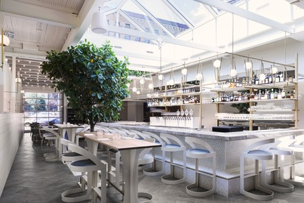 "Press kit | 788-05 - Press release | Restaurant ""Perles et Paddock"" - FX Studio by clairoux - Commercial Interior Design - interior design restaurant  connected with the industrial area, bar and skylight light marble counter top herringbone porcelain on the floor, triangular mosaic front bar, nature inside decoration - Photo credit: atelier welldone"