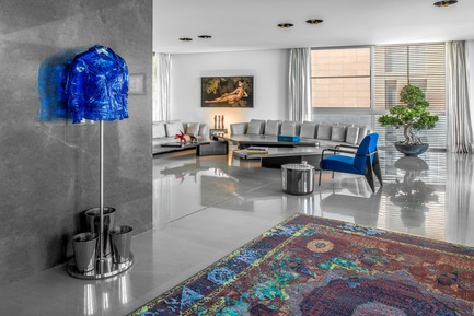 "Press kit | 2769-02 - Press release | One Oak 3&4 B2 - Askdeco - Residential Interior Design - -Sofa lounge ""Seymour""  Minotti<br>-Coffee Table by Hawini Lebanese Artist <br>-Carpet: Jan Kath Erased Heritage<br>-Blue Armchair Vitra designed by Jean Prouvé<br>-Side Table - Sé London ""Bala Lo"" Carrara marble top shell in metal glaze<br>-Blue Jacket statue ""Perfecto Blue"" by Richard Orlinski<br>-Baobab Candles ""Les exclusives platinum""<br>-Side Table ""Strata"" Amma Studio under painting <br>-Painting in the back - by Yasmina Alaoui- Guerra<br> - Photo credit: Alex Jeffries"