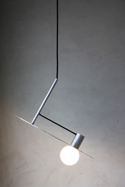 Dossier de presse | 1895-04 - Communiqué de presse | L A M P Finalists Announced for Fifth Annual International Lighting Design Competition - L A M P (Lighting Architecture Movement Project) - Lighting Design -                  L n°004 by Pierric De Coster from         Antwerp, Belgium. The pendant lamp is characterized by its simplicity and pure form. Stripped of all unnecessary, a logical composition of cylindrical shapes creates a subtle and poetic object.        The lamp only consists of three cylindrical aluminum pieces, a light source and a power cord.  - Crédit photo :  L A M P