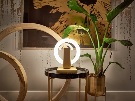 Press kit | 3412-02 - Press release | Karice, Award Winning Designer Unveils its Latest Luminaire - Olah Table Lamp - Karice Enterprises Ltd. - Product - Olah Table Lamp - placed on a side table toning in with gold accents - Photo credit: Jordan N. Dery