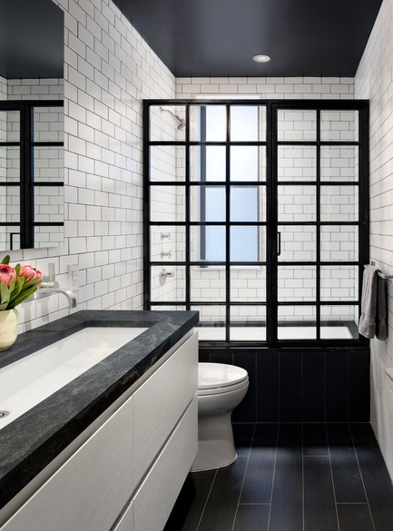 Press kit | 2875-06 - Press release | Park Slope Duplex Apartment - BFDO Architects - Residential Interior Design -  Children's bath with Custom blackened steel shower enclosure. Tile by Nemo and vanity by Furniture Guild. Countertio is Jet Mist.  - Photo credit: Amy Barkow