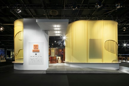 "Press kit | 2704-05 - Press release | ""Das Haus"" 2019 at the imm cologne: Living by moods creates an appetite for open-plan homes - imm cologne 2019, Koelnmesse GmbH - Residential Interior Design - For Studio Truly Truly, who designed Das Haus 2019 for the international furniture and interiors fair imm cologne, contemporary living means a naturally flowing and organic interior. The camouflage pattern on the curtains surrounding Das Haus 2019 is a metaphor for the designer couple's organic concept. - Photo credit: Constantin Meyer; Koelnmesse"